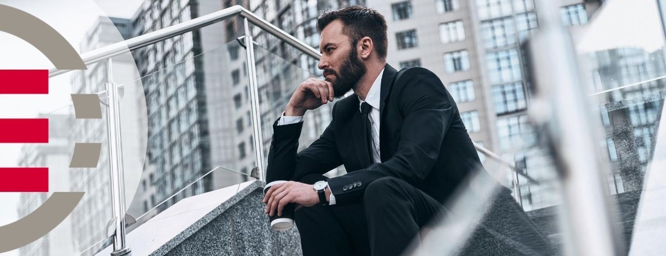 Man sitting on stairs thinking about how to nurture his buyer leads towards a sale